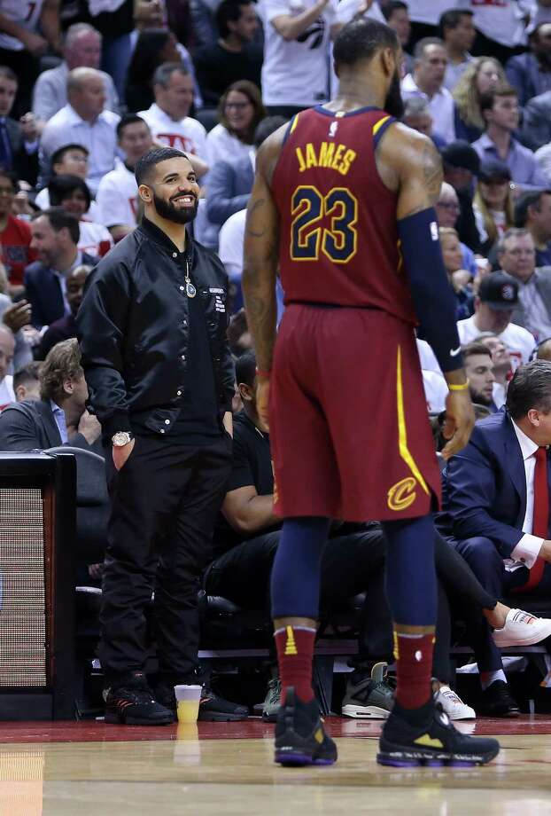 TORONTO, ON - MAY 01:  Rapper Drake smiles at LeBron James #23 of the Cleveland Cavaliers in the second half of Game One of the Eastern Conference Semifinals against the Toronto Raptors during the 2018 NBA Playoffs at Air Canada Centre on May 1, 2018 in Toronto, Canada.  NOTE TO USER: User expressly acknowledges and agrees that, by downloading and or using this photograph, User is consenting to the terms and conditions of the Getty Images License Agreement. Photo: Vaughn Ridley, Getty Images / 2018 Getty Images