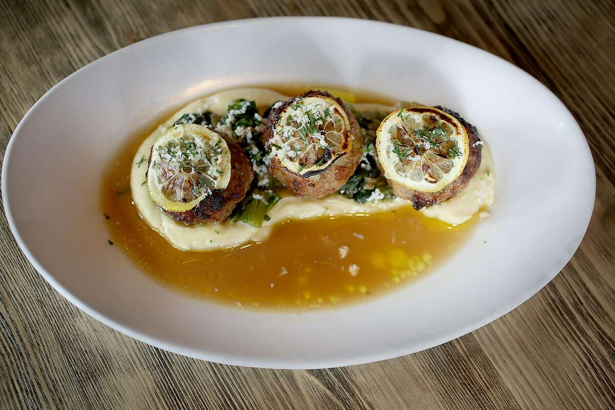 Lemon and Ricotta Polpette--pan roasted pork meatballs with braised escarole, celery root puree, ricotta salt, citrus park jus--served at AltoVino on Friday, April 27, 2018, in San Francisco, Calif.