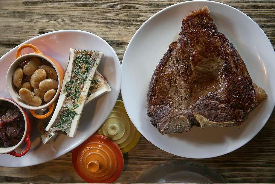 AltoVino's La Fiorentina ($79), includes a 1-kilo dry-aged porterhouse steak served with corona beans and roasted bone marrow. Photo: Liz Hafalia / The Chronicle