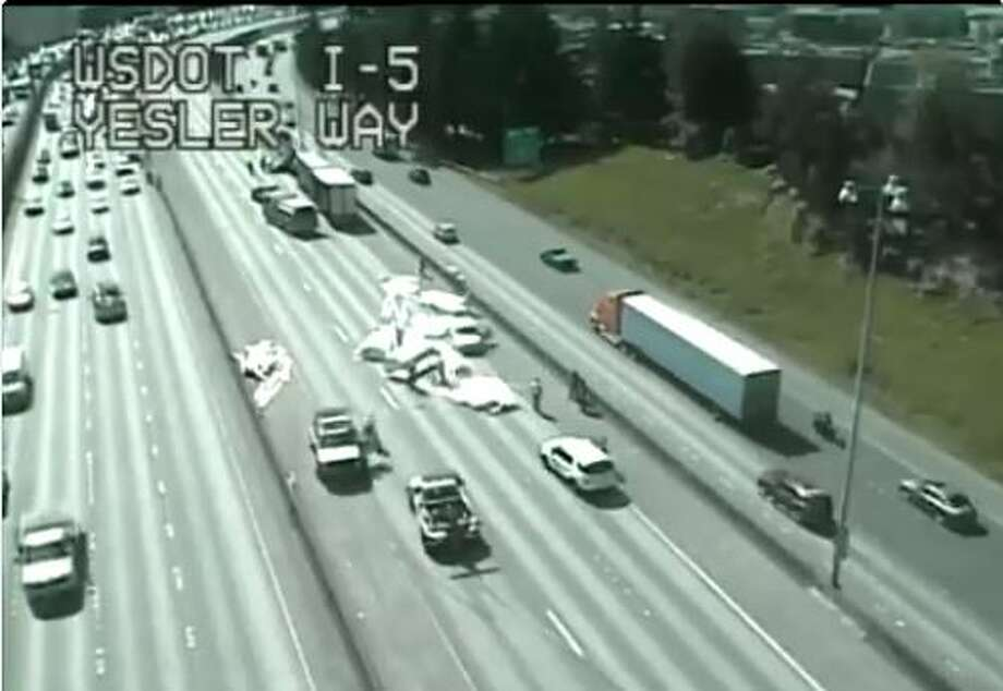 Southbound Interstate 5 was shut down at Yesler Way in downtown  Seattle Wednesday morning after a semi truck spilled its load of lumber  onto the roadway, according to the state Department of Transportation. Photo: WSDOT