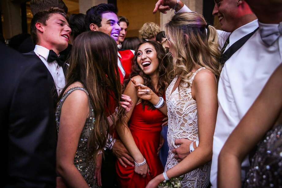 Kelly Danoff (center), her boyfriend Ryan Miller (third from left) and their other friends dance during prom night at the Bentley Reserve in San Francisco. Both Ryan and Kelly lost their homes in the Santa Rosa fires last October. Their school was also severely damaged. Photo: Photos By Gabrielle Lurie / The Chronicle