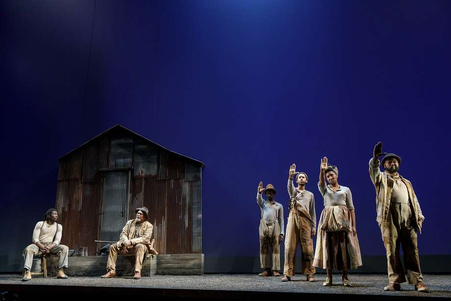 """Members of the company of """"Father Comes Home from the Wars (Parts 1, 2 & 3),"""" a co-production of ACT and Yale Repertory Theatre. Photo: Joan Marcus / ACT And Yale Repertory Theatre / Joan Marcus"""