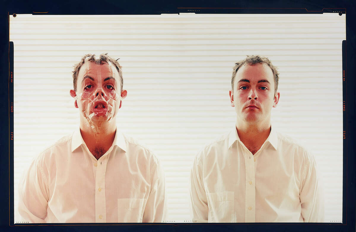 """Douglas Gordon transforms his face with tape in """"Monster Reborn"""" (2002) at the Gagosian Gallery in San Francisco."""