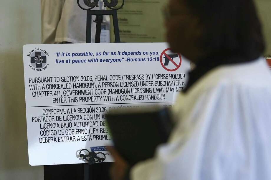 A churchgoer walks past a no concealed carry sign in the entrance at St. James Episcopal Church Sunday, March 4, 2018 in Houston. (Michael Ciaglo / Houston Chronicle) Photo: Michael Ciaglo, Houston Chronicle / Houston Chronicle / Michael Ciaglo