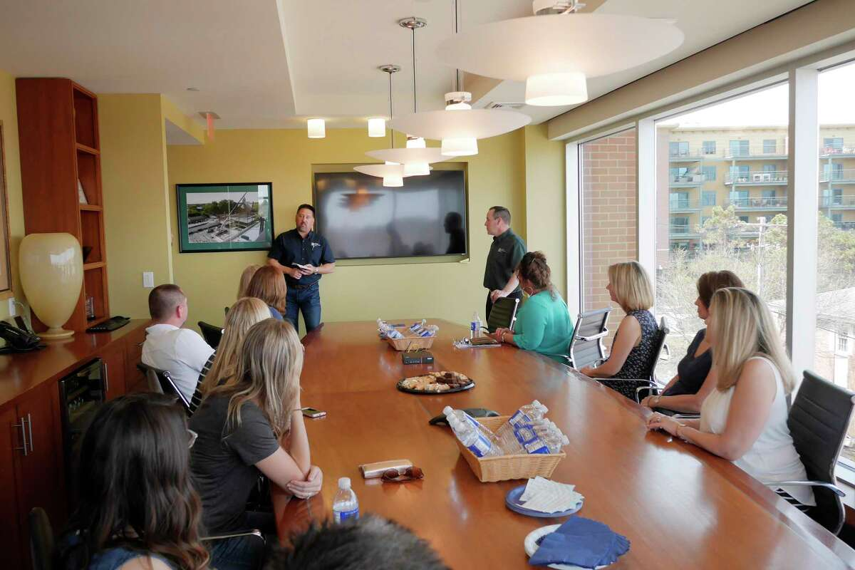 Sonny Bonacio, background left, president and owner of Bonacio Construction, and Paul Lambert, background right, a project manager for Bonacio Construction, talk to BOCES guidance counselors from around New York State on Wednesday, May 2, 2018, in Saratoga Springs, N.Y. (Paul Buckowski/Times Union)