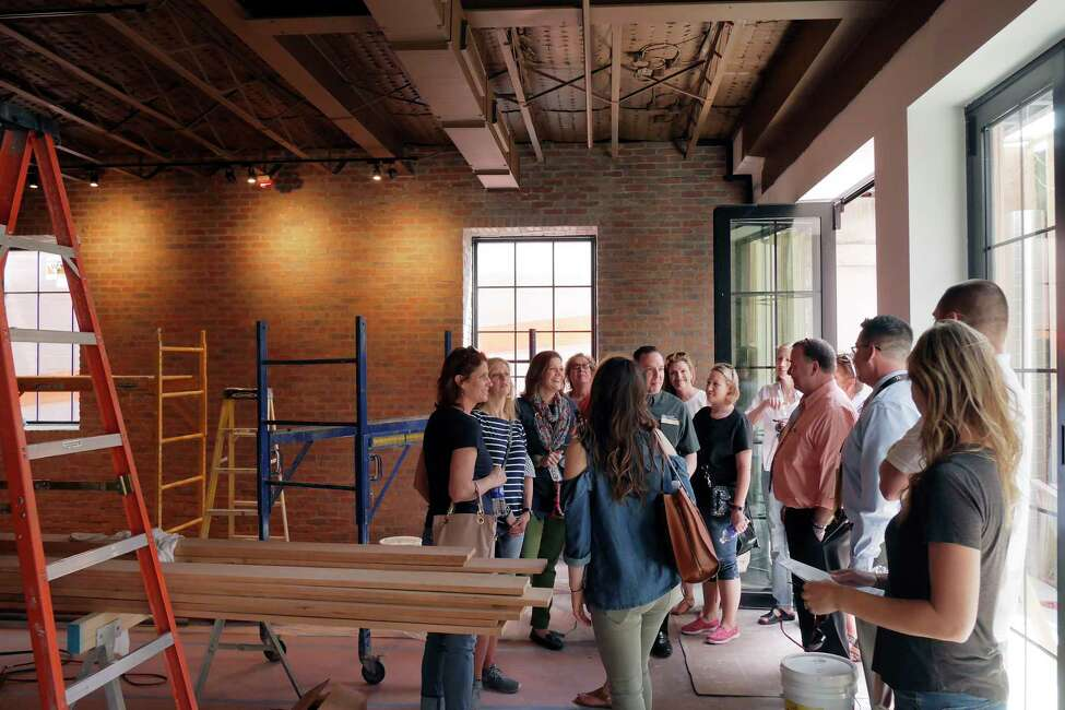 Paul Lambert, background center, a project manager with Bonacio Construction, gives a tour of one of their construction sites on Broadway to BOCES guidance counselors from around New York State on Wednesday, May 2, 2018, in Saratoga Springs, N.Y. The BOCES guidance counselors were visiting with employees of Bonacio Construction to see what the construction industry is looking from from students entering the workforce. (Paul Buckowski/Times Union)