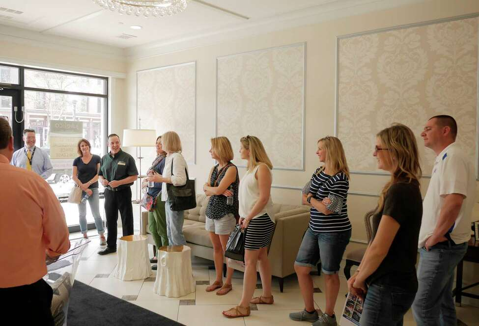 Paul Lambert, third from left, a project manager with Bonacio Construction, gives a tour of one of the buildings Bonacio Construction owns, to BOCES guidance counselors from around New York State on Wednesday, May 2, 2018, in Saratoga Springs, N.Y. The BOCES guidance counselors were visiting with employees of Bonacio Construction to see what the construction industry is looking from from students entering the workforce. (Paul Buckowski/Times Union)