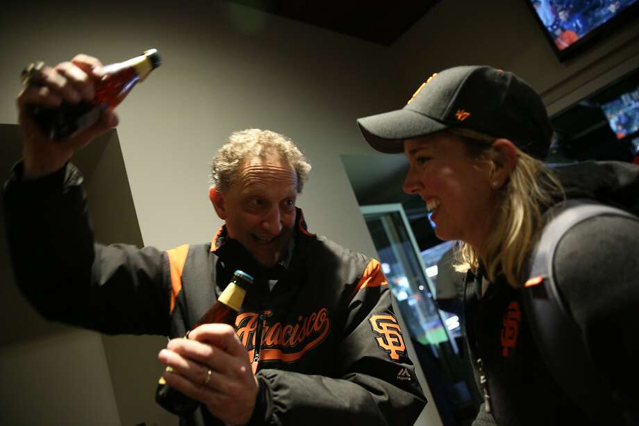 Giants CEO Larry Baer and Heather Knight celebrate Total Muni 2018 at AT&T Park. Photo: Santiago Mejia / The Chronicle