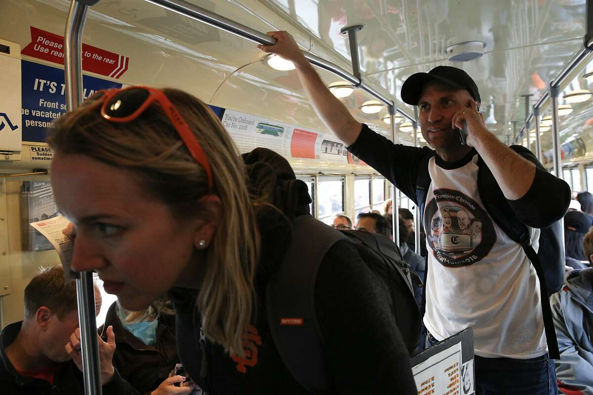 From left: Heather Knight checks the stops with Peter Hartlaub in the E-Embarcadero, Monday, April 30, 2018, in San Francisco, Calif.