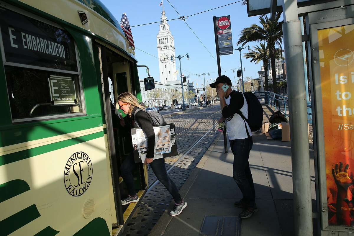 From left: Heather Knight and Peter Hartlaub take the E-Embarcadero, Monday, April 30, 2018, in San Francisco, Calif.