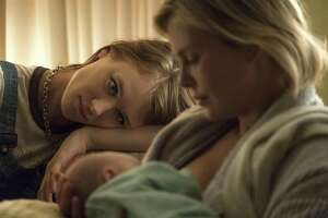"""Mackenzie Davis, left, and Charlize Theron in a scene from """"Tully."""""""