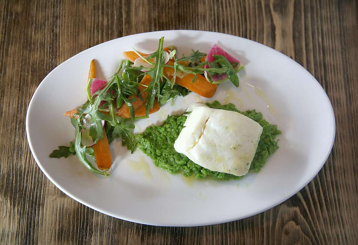Alaskan Halibut roasted under a salt crust--snap peas, baby carrots, spring onion, wild arugula, lemon agrumato--served at AltoVino on Friday, April 27, 2018, in San Francisco, Calif.