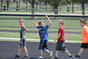 Cass City Elementary participated in All Children Exercising Simultaneously (ACES) Day on Wednesday at the high school football field. Students in grades kindergarten through sixth did a lap around the track, stretches, yoga, push-ups, and dancing all led by physical education teacher Adam Dorland.