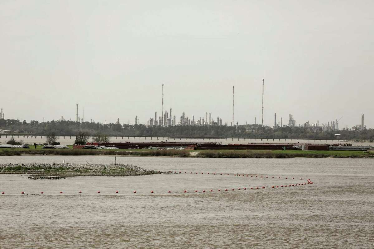 Orange buoys mark the boundaries of waste pits that have ended up under water and are contaminated by dioxins from a paper mill. The site flooded again during Hurricane Harvey. photographed on Thursday, March 1, 2018, in Highlands. ( Elizabeth Conley / Houston Chronicle )