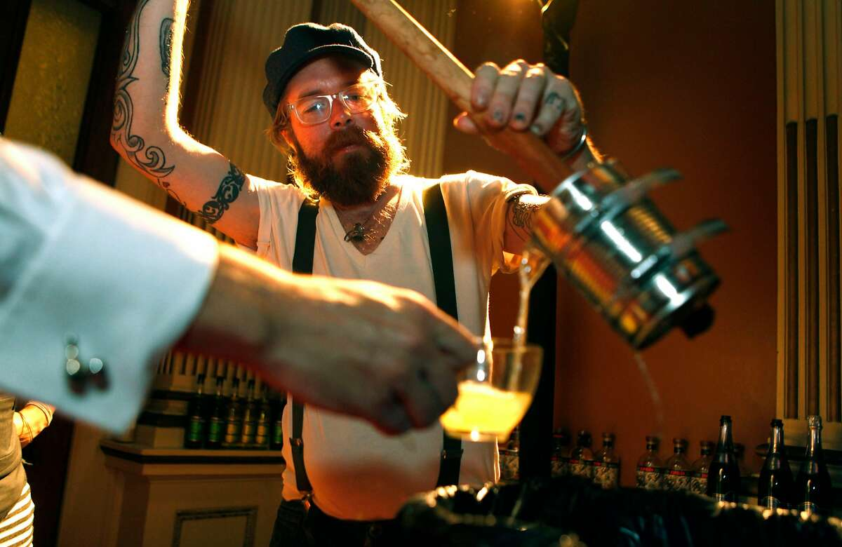 Daniel Hyatt pours a sample of his handcrafted punch at the Barbary Coast-Era Cocktail Carnival Saturday, Sept. 25, 2010, at the San Francisco's historic Old Mint.