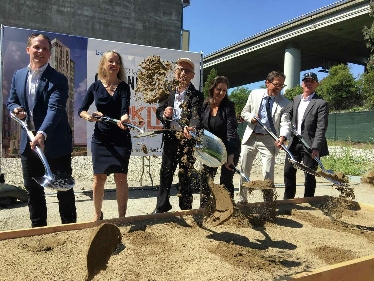 Developers and city officials mark the groundbreaking of the Skylyne housing project.