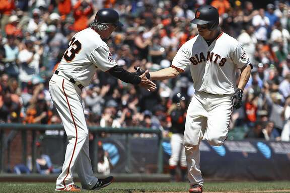 San Francisco Giants' Nick Hundley, right, is congratulated by third base coach Ron Wotus (23) after hitting a two-run home run off San Diego Padres' Clayton Richard in the fourth inning of a baseball game Wednesday, May 2, 2018, in San Francisco. (AP Photo/Ben Margot)