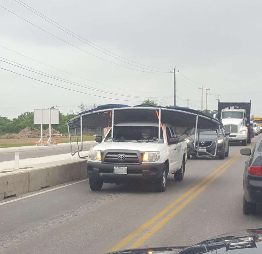 The odd sight of a trampoline strapped and hanging well over a Toyota pickup truck is making the rounds on the San Antonio subreddit. The photo shows the structure scraping the edges of the lane.