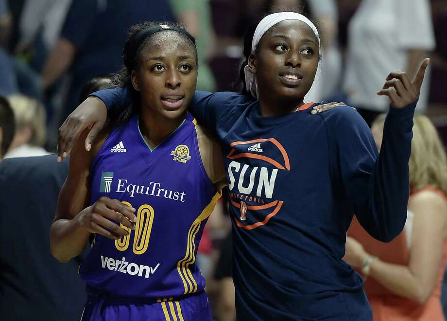 In this May 26, 2016, file photo, sisters Nneka Ogwumike, left, and the Sun's Chiney Ogwumike, right, walk off the court together at the end of a WNBA game. The Sun star learned Tuesday that she will be a full time basketball analyst for the NBA at ESPN. At 26, she is one of the youngest analysts at the network and one of few women in that role. Photo: Jessica Hill / Associated Press / AP2016