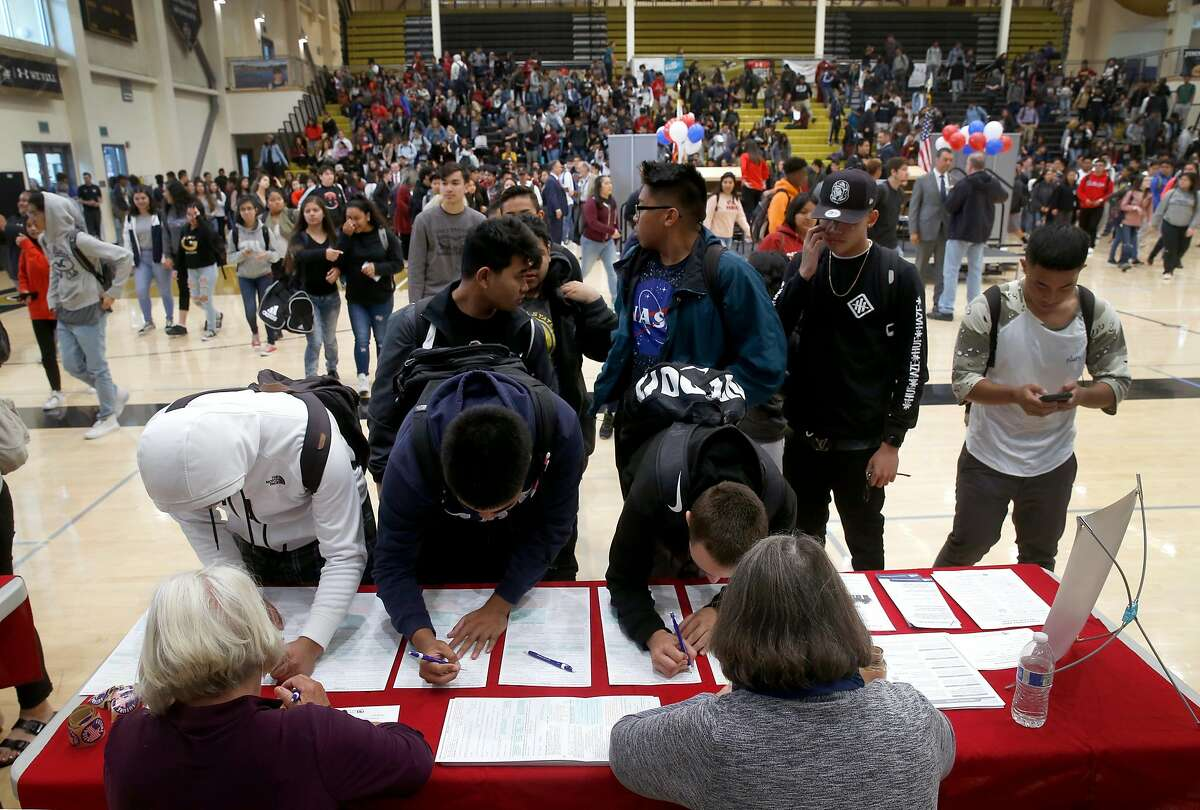 Students at American Canyon High School line up to fill out voter registration forms at a rally in American Canyon, Calif. on Thursday, April 26, 2018.