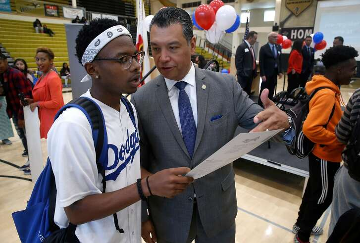 California Secretary of State Alex Padilla answers a question about the application for student Zyierre Smith at a voter registration rally at American Canyon High School in American Canyon, Calif. on Thursday, April 26, 2018.