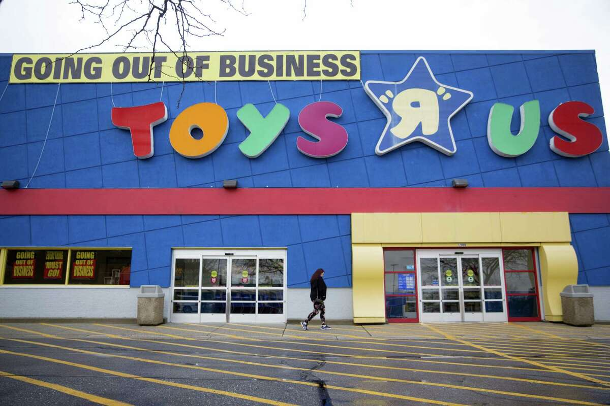 A shopper walks towards the entrance of a Toys R Us Inc. retail store in Frederick, Maryland, U.S., on Monday, April 16, 2018. Billionaire Isaac Larian, the toy marketer whose lineup includes Little Tikes and Bratz dolls, offered to save part of Toys