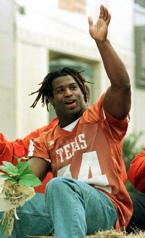 University of Texas running back Ricky Williams waves from a parade float as it moves through downtown Austin, Texas, on Thursday, Jan. 28, 1999.  >>How much the highest paid NFL players make as of last year.  Photo: JACK PLUNKETT, STR / AP / AP