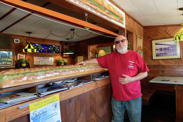 Neptune Subs business operation and owner, Vinny Schillaci poses Oct. 18 inside his shop along Texas 146 in Seabrook, prior to its closing last year in preparation for the highway's widening.