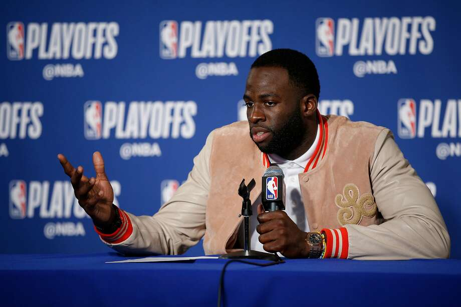 Warriors forward Draymond Green holds court while speaking with reporters after Game 2 on Tuesday against the Pelicans, a 121-116 victory. Photo: Santiago Mejia / The Chronicle