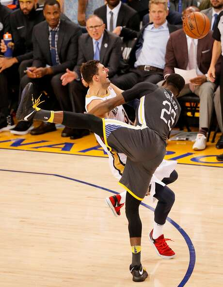 Golden State Warriors' Draymond Green and New Orleans Pelicans' Nikola Mirotic collide in the fourth quarter during game 2 of the Western Conference Semifinals at Oracle Arena on Tuesday, May 1, 2018 in Oakland, Calif. Photo: Michael Macor / The Chronicle