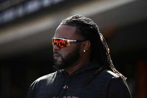 SAN FRANCISCO, CA - APRIL 03:  Johnny Cueto #47 of the San Francisco Giants stands in the dugout during their game against the Seattle Mariners at AT&T Park on April 3, 2018 in San Francisco, California.  ~~
