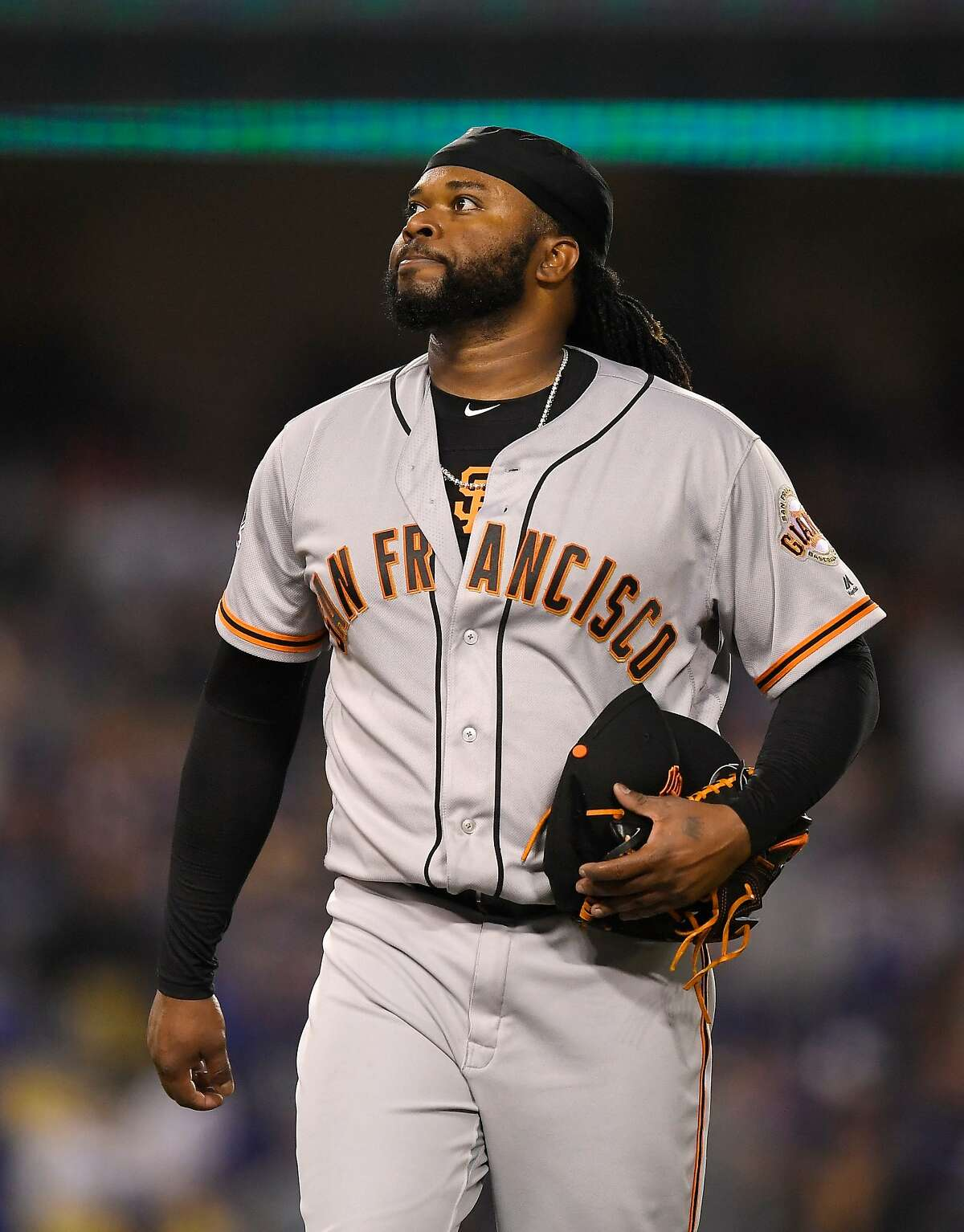 San Francisco Giants starting pitcher Johnny Cueto walks off the field after completing the seventh inning of a baseball game against the Los Angeles Dodgers Friday, March 30, 2018, in Los Angeles. Cueto had a no-hitter going into the seventh inning until Los Angeles Dodgers' Chris Taylor hit a single, breaking it up.