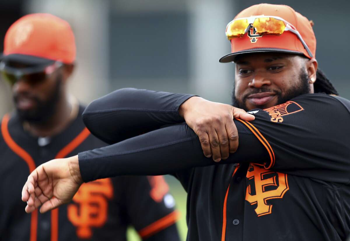 San Francisco Giants' Johnny Cueto, right, stretches during a spring training baseball practice on Monday, Feb. 19, 2018 in Scottsdale, Ariz. (AP Photo/Ben Margot)