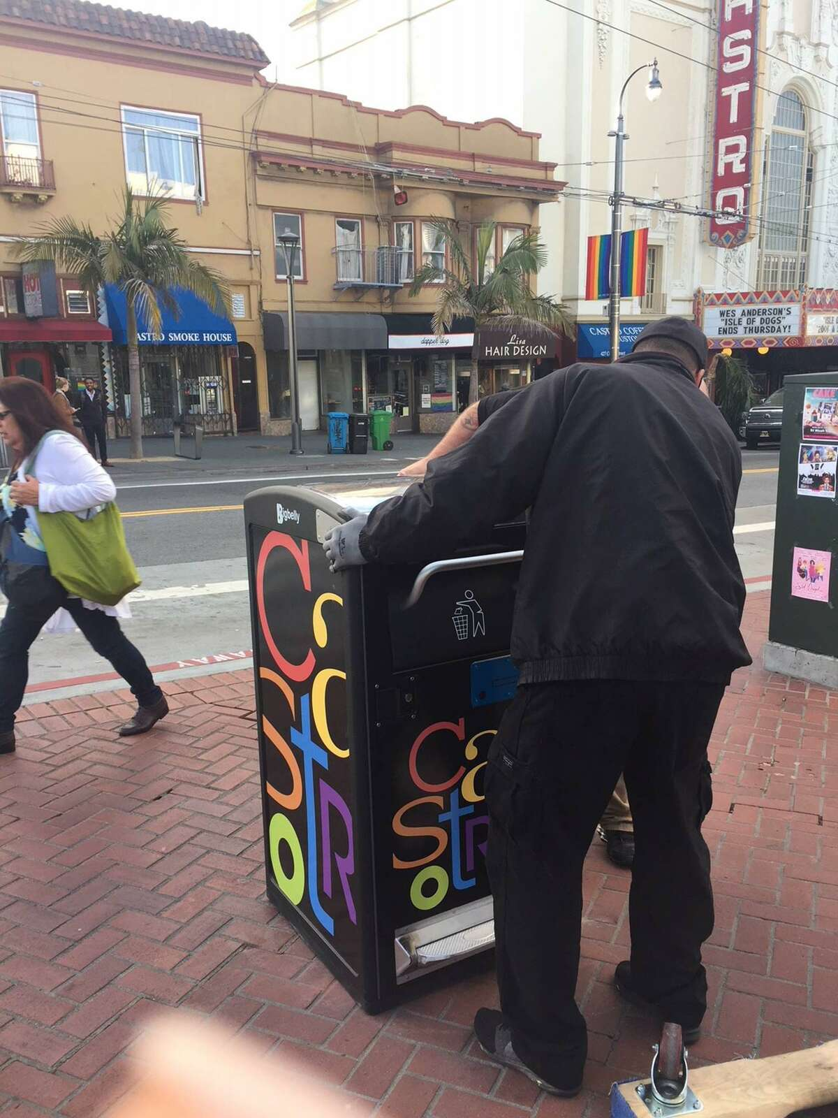 Workers install a Bigbelly trash bin near the Castro Theatre in San Francisco on Tuesday May 1, 2018.