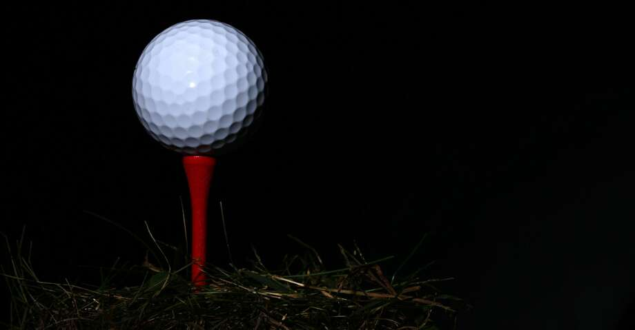 A studio shot of a Golf Ball on a tee. 20th October 2012. Photo Tim Clayton (Photo by Tim Clayton/Corbis via Getty Images) Photo: Tim Clayton - Corbis/Corbis Via Getty Images