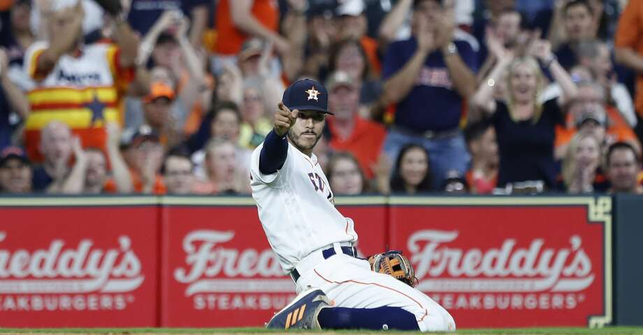 PHOTOS: Astros game-by-game Houston Astros shortstop Carlos Correa (1) reacts after making a long throw to first as New York Yankees Tyler Austin ground out during the eighth inning of an MLB game at Minute Maid Park, Tuesday, May 1, 2018, in Houston. ( Karen Warren  / Houston Chronicle ) Browse through the photos to see how the Astros have fared through each game this season. Photo: Karen Warren/Houston Chronicle