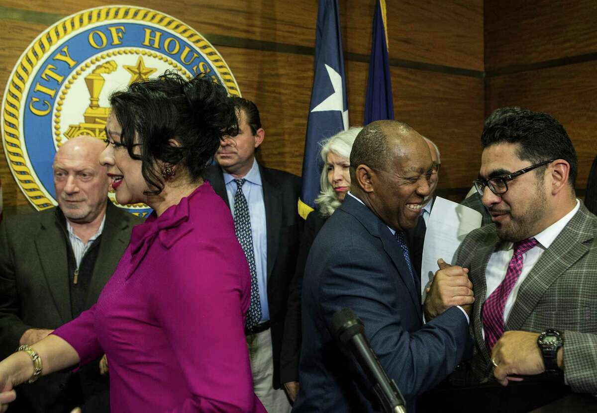 Dr. Laura Murillo, president and CEO of the Hispanic Chamber of Commerce, left, mingles with the crowd as Mayor Sylvester Turner, center, speaks to State Rep. Armando Walle, following a news conference urging Senators John Cornyn and Ted Cruz, along with other congressional leaders, to act on finding a permanent solution protecting DACA recipients, on Monday, Jan. 29, 2018, in Houston. ( Brett Coomer / Houston Chronicle )