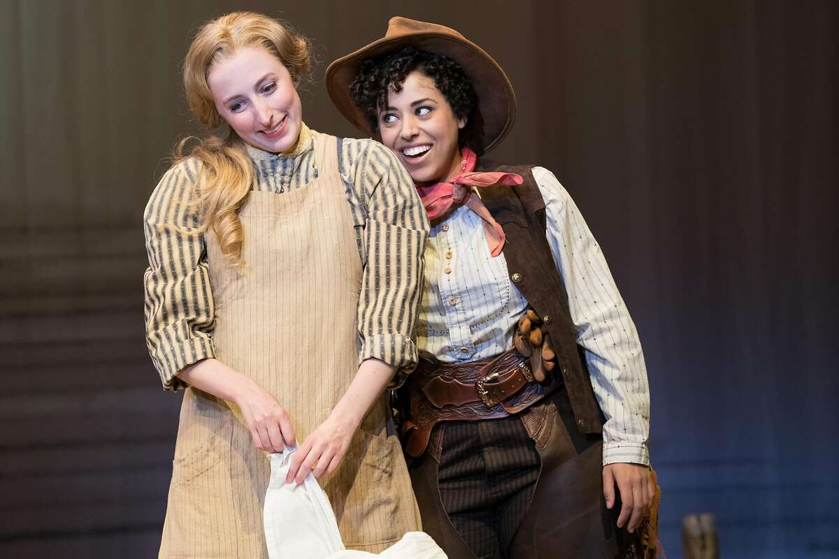 """Curly (Tatiana Wechsler, right) tries to entice Laurey (Royer Bockus) into accompanying her to the box social in Oregon Shakespeare Festival's """"Oklahoma!"""""""