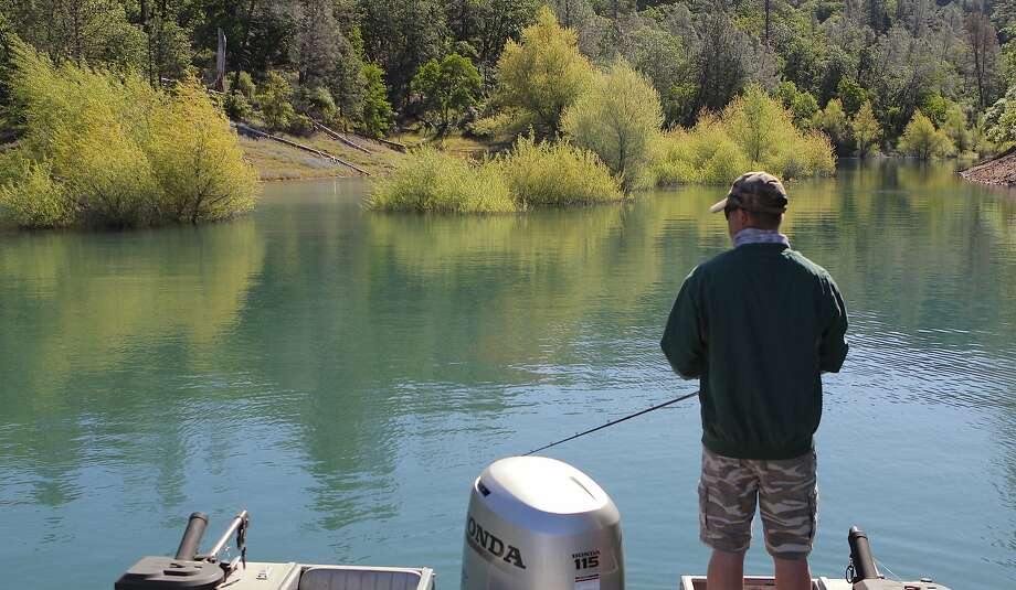 Jeremy Keyston stalks a cove at Shasta Lake to cast for bass and crappie Photo: Tom Stienstra / Tom Stienstra / The Chronicle