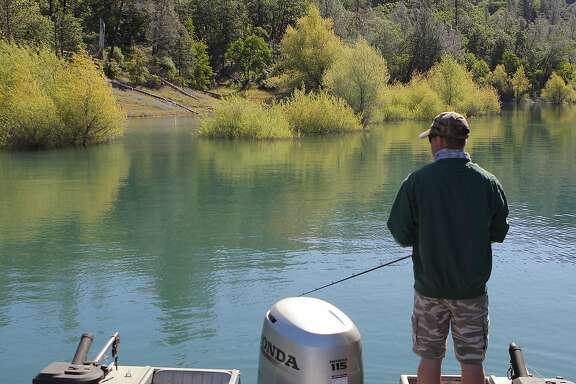 Jeremy Keyston stalks a cove at Shasta Lake to cast for bass and crappie