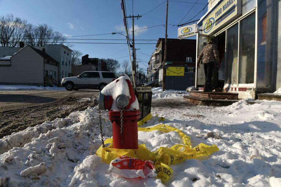 Crime scene tape is wrapped around a fire hydrant on Friday morning, Jan. 5, 2018, at the corner of First and Quail Streets where Anthony Malloy, 35, of Albany was gunned down on Thursday in Albany, N.Y. Malloy was crossing the street when someone opened fire at the intersection at 2 p.m. (Will Waldron/Times Union) Photo: Will Waldron