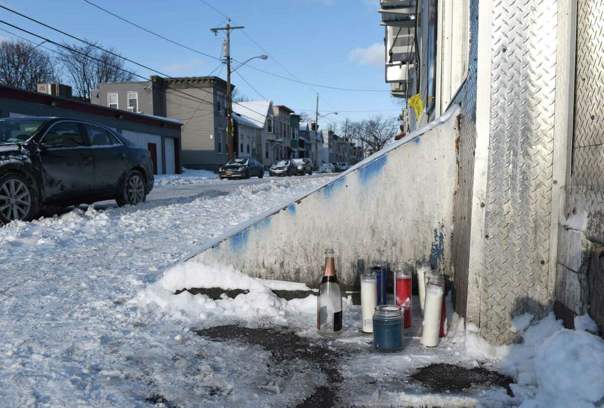 A make-shift memorial is assembled for Anthony Malloy, 35, of Albany who was gunned down Thursday at the corner of First and Quail Streets on Friday morning, Jan. 5, 2018, in Albany, N.Y. Malloy was crossing the street when someone opened fire at the intersection at 2 p.m. (Will Waldron/Times Union)