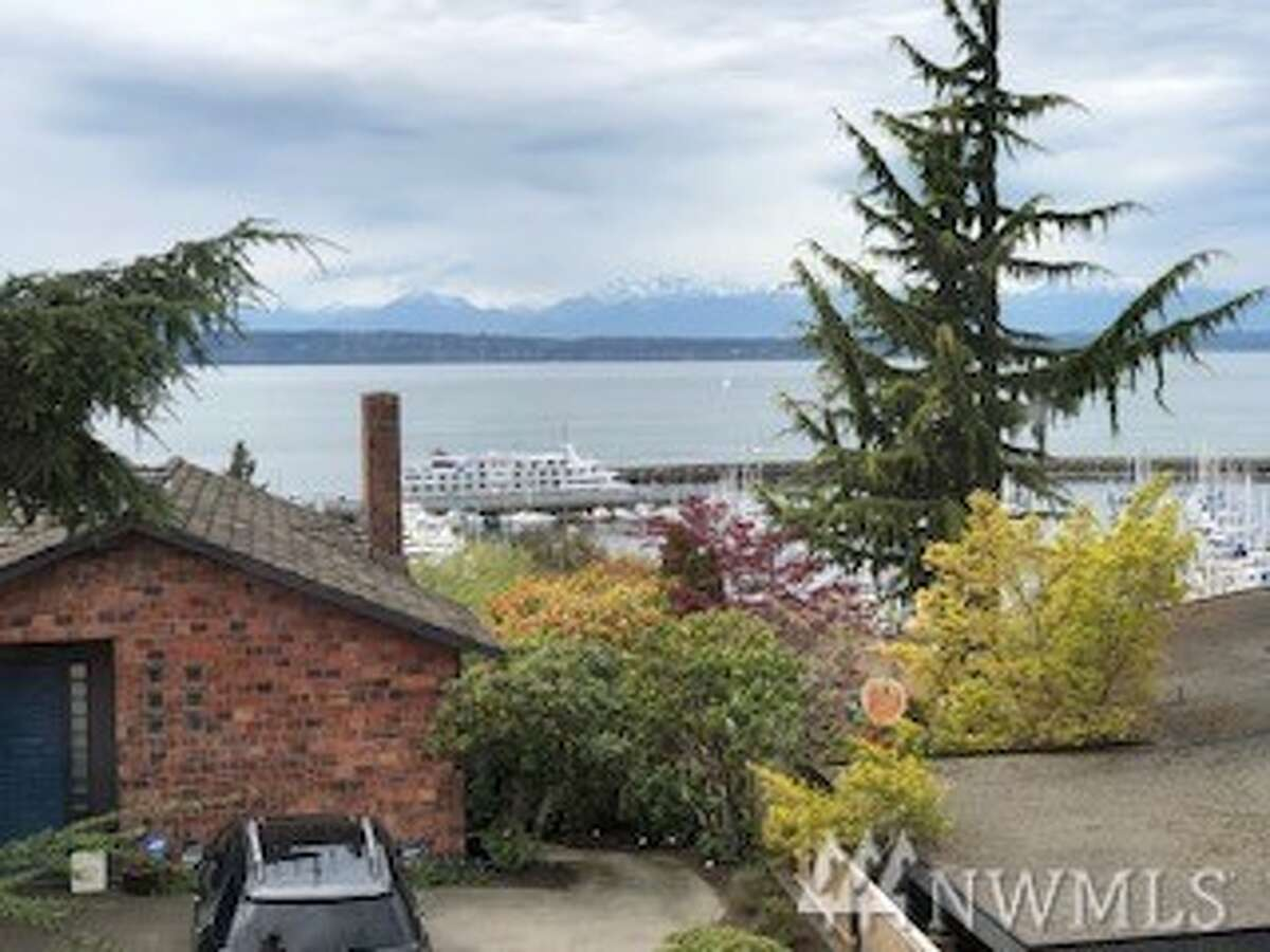 Views from the home include the bay and the Olympic Mountains, and it's walking distance to Shilshole Bay Marina.