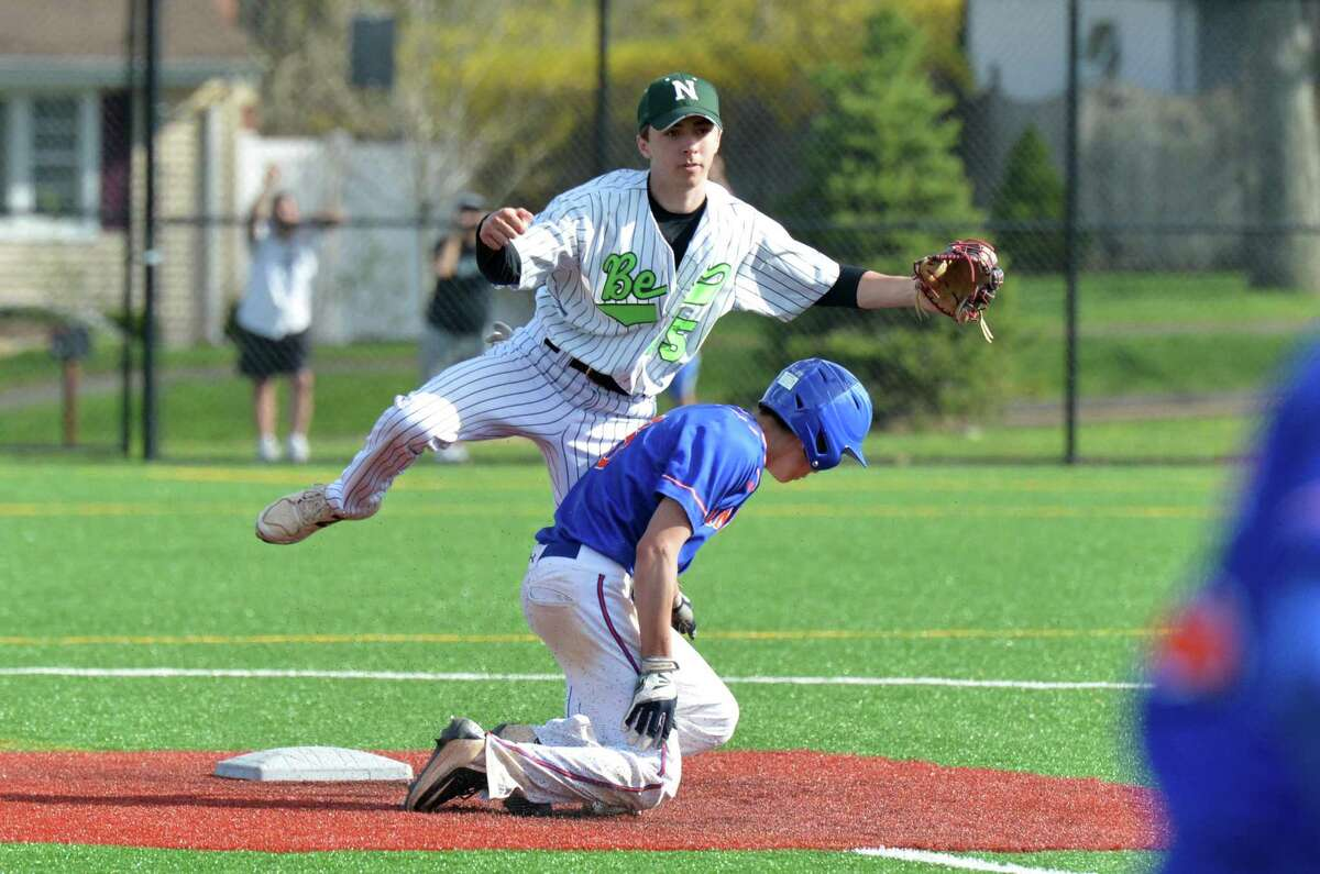 Norwalk's #15 Jack Arnold makes the tag on the plate and the out on Danbury's #6 Justin Hope, then throws to first base in baseball action vs. Danbury High School on Wednesday May 2, 2018 in Norwalk Conn.