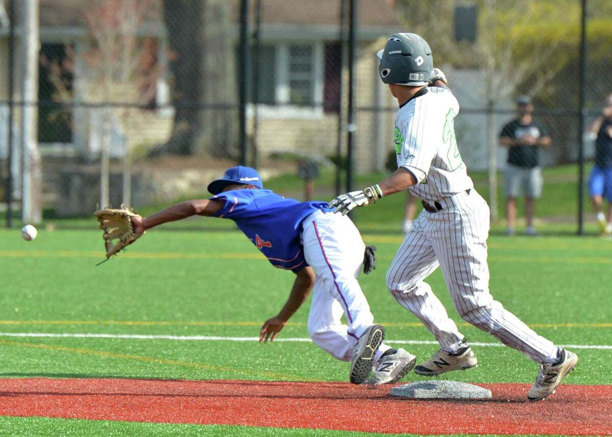 Norwalk's Kyle Gordon is safe at second base as Danbury's Javon Hernandez reaches for the ball in Wednesday's game.