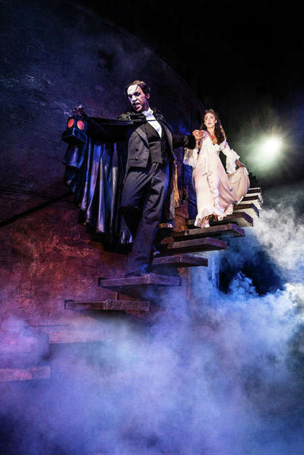 Quentin Oliver Lee as The Phantom, and Eva Tavares as Christine Daaé. Photo:       Photos By Matthew Murphy|