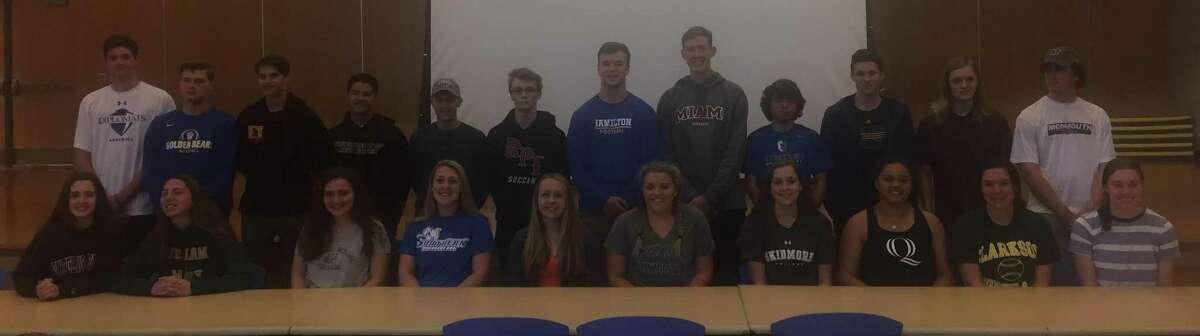 More than two dozen senior student-athletes at Newtown High School finalized their college plans at a signing-day ceremony at the school May 2, 2018.