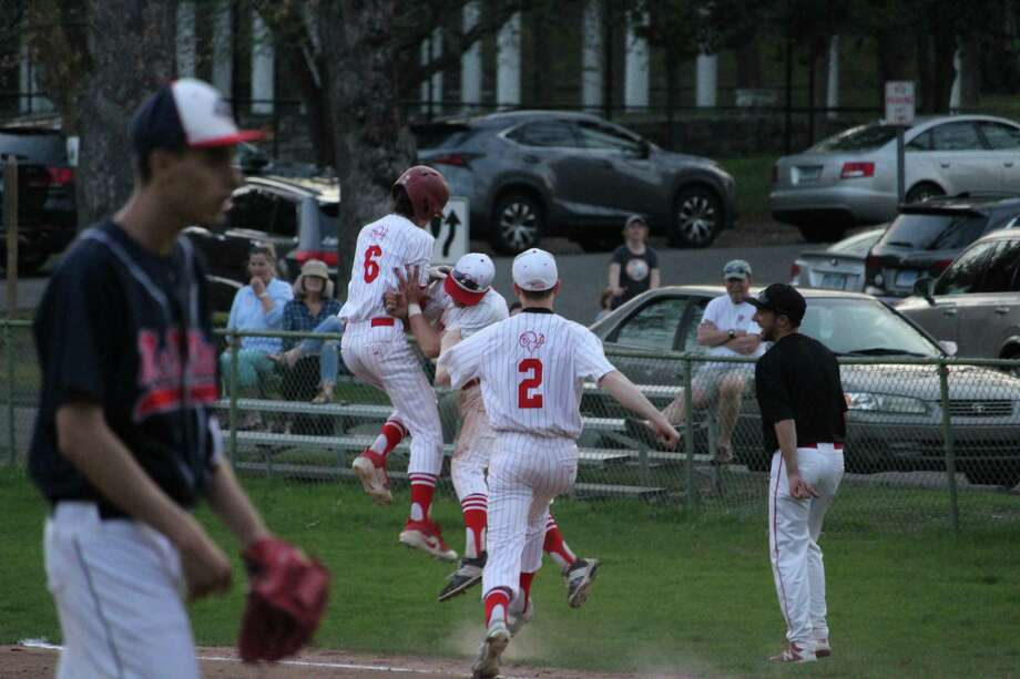 New Canaan's Ben Sarda (6) is mobbed by teammates after his walk-off single in the ninth inning of an FCIAC Baseball game between New Canaan and Brien McMahon at Mead Park in New Canaan, Conn. on Wednesday May 2, 2018. New Canaan won 15-14 in nine innings. Photo: Anthony E. Parelli / Hearst Connecticut Media / New Canaan News