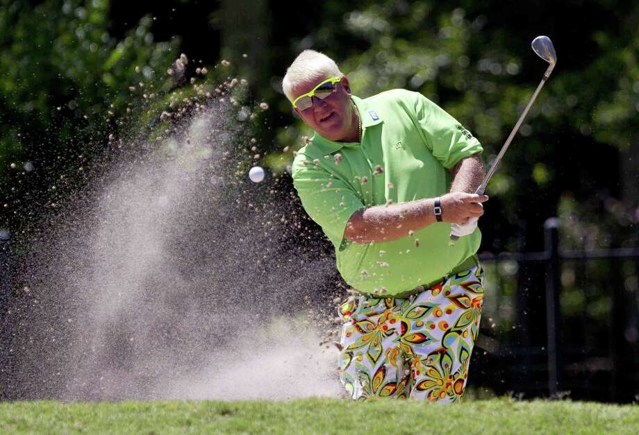John Daly hits out of a bunker onto the 16th green during the Pro-Am of the Insperity Invitational golf tournament Wednesday. Daly will make his inaugural tournament on the PGA Tour Champions debut at this week's Insperity Invitational. Photo: Jason Fochtman / Internal
