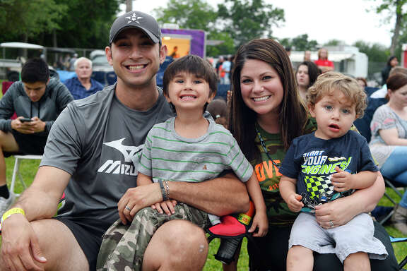 Scott and Kayla Meyer with Jackson and Waylon at the opening night of the Port Neches Riverfest. The festival continues through Sunday.  Photo taken Wednesday 5/2/18 Ryan Pelham/The Enterprise